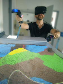 Augmented reality sandbox and virtual reality